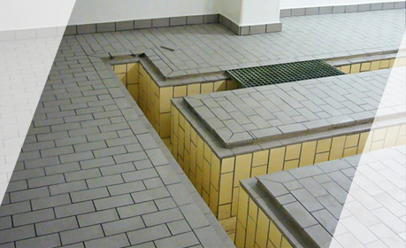 Ceramic brick lining on the floor and in the channels